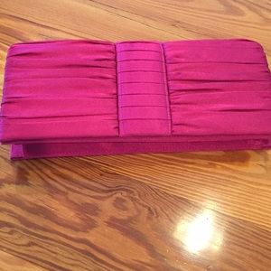 Clutch evening bag in a raspberry color satin.